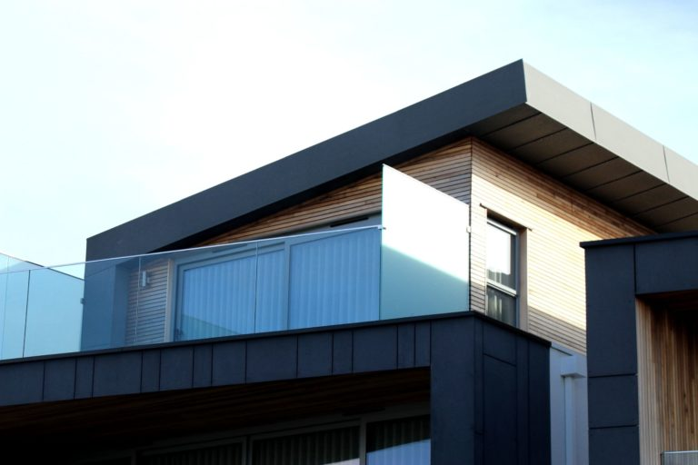Metal roofed building with balcony