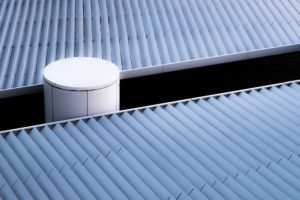 Metal roofing with gap and vent.