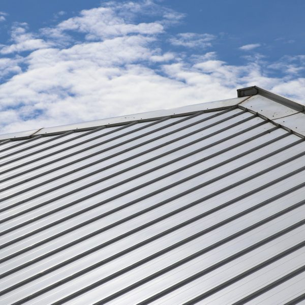 Close up metal roof with sky.